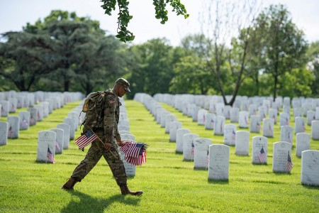 Soldiers from the 3d U.S. Infantry Regiment (The Old Guard) place U.S. flags at headstones as part of Flags-In at Arlington National Cemetery, Arlington, Va., May 23, 2019. For more than 55 years, Soldiers from the Old Guard have honored our nation's fallen heroes by placing U.S. flags at gravesites for service members buried at both Arlington National Cemetery and the U.S. Soldiers' and Airmen's Home National Cemetery just prior to the Memorial Day weekend. Within four hours, over 1,000 soldiers place 245,000 flags in front of every headstone and Columbarium and niche wall column. (U.S. Army photo by Elizabeth Fraser)