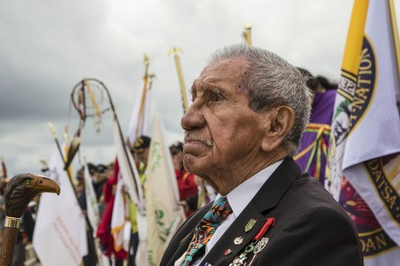 Native American WWII veteran Charles Say reflects at the shores of Omaha Beach, France, June 5, 2019. More than 1,300 U.S. Service Members, partnered with 950 troops from across Europe and Canada converged in northwestern France to commemorate the 75th anniversary of Operation Overlord, the WWII Allied Invasion of Normandy, commonly known as D-Day. (U.S. Army photo by Sgt. Dommnique Washington)