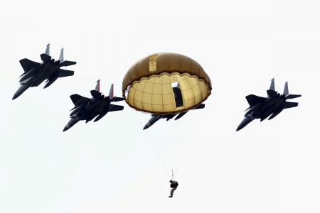 More than 1,100 parachutes sailed above Sainte-Mere-Eglise, France, to commemorate the 75th Anniversary of D-Day, June 9, 2019. Allied Forces began the liberation of Europe on the beaches and in the skies of Normandy during WWII. 19 aircraft from multiple nations and paratroopers from Belgium, France, Germany, the Netherlands, Romania, United Kingdom and the United States dropped civilians and Soldiers, both freefall and static line, in front of tens of thousands of spectators. (U.S. Army photo by Pfc. Alisha Edwards)