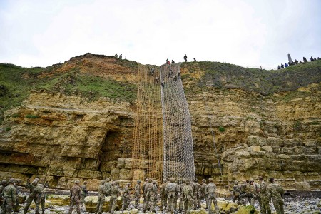 U.S. Army Rangers climb the cliffs at Pointe du Hoc, in Cricqueville en Bessin, France, June 4, 2019. Rangers scale the cliff to honor the 135 men killed or wounded while capturing and holding Pointe du Hoc. More than 1,300 U.S. service members partnered with 950 troops from across Europe and Canada to commemorate the 75th anniversary of Operation Overlord, the World War II Allied invasion of Normandy, commonly known as D-Day. (U.S. Air Force photo by Master Sgt. Andy M. Kin)