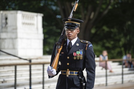 A sentinel from the 3d U.S. Infantry Regiment (The Old Guard) walks the mat at the Tomb of the Unknown Soldier, Arlington National Cemetery, Arlington, Va., July 1, 2019. (U.S. Army photo by Elizabeth Fraser)