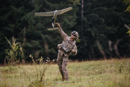 A U.S. Army paratrooper assigned to the 1st Battalion, 503rd Infantry Regiment, 173rd Airborne Brigade, throws a small unmanned aircraft system (SUAS) Raven into flight prior to expected enemy contact in Hohenfels Training Area, Germany, during Saber Junction 19, Sept. 22, 2019. (U.S. Army photo by Spc. Ryan Lucas)