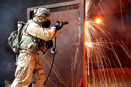 A Soldier breaches a steel door with an exothermic cutting torch during training in the Republic of Korea. The torch is just one of many tools engineers use to breach obstacles. The Soldier is with 3rd Brigade Engineer Battalion, 3rd Armored Brigade Combat Team, 1st Cavalry Division. (U.S. Army photo by Capt. Scott Kuhn)