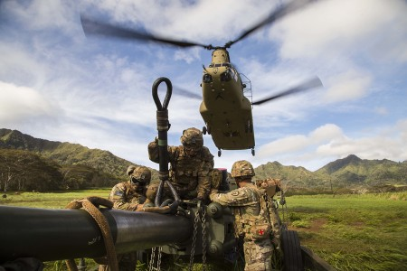 Soldiers prepare to sling load their M777 Howitzer onto a CH-47 Chinook helicopter during a two-gun raid air assault exercise Oct. 10, 2019 at Schofield Barracks, Hawaii. The coordinated exercise was the first live fire air assault of M777 Howitzers ever conducted on the island of Oahu and shows the Army's ability to rapidly project our forces over any terrain in any conditions. (U.S. Army photo by Sgt. Thomas Calvert)