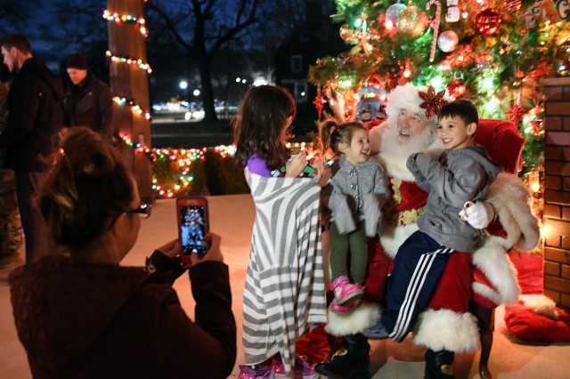 Jessica Clark photographs her children speaking to Santa at Fort Knox's annual Christmas tree lighting ceremony Dec. 6 2019.