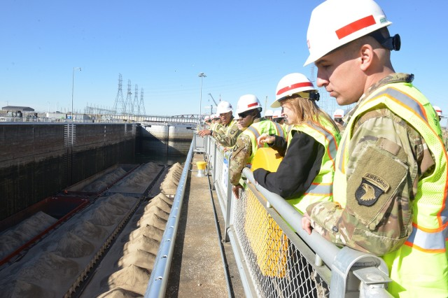 A group of Soldiers from Fort Campbell's 326th Engineer Battalion, 101st Airborne Division watch a barge lock through at the Kentucky Lock Addition Project in Grand Rivers, Ky.