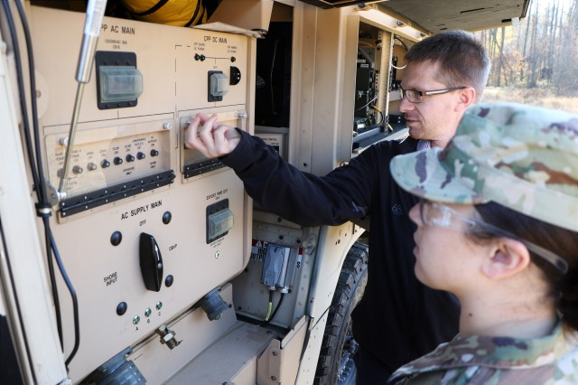 Army C5ISR Center mechanical engineer Mark Miltenberger (left) and enlisted advisor Sgt. Keila Peters conduct testing on Command Post Integrated Infrastructure components at Aberdeen Proving Ground, Maryland, in December 2019.
