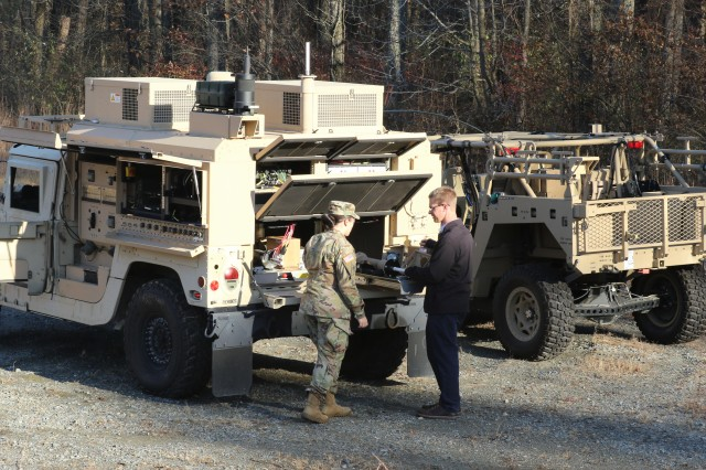 Army C5ISR Center enlisted advisor Sgt. Keila Peters (left) and mechanical engineer Mark Miltenberger conduct testing on Command Post Integrated Infrastructure components at Aberdeen Proving Ground, Maryland, in December 2019.
