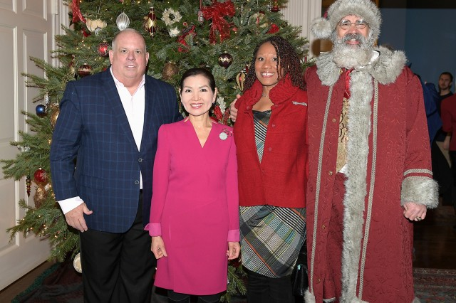 """Todd Bishop, right, known around the holidays as """"Santa Todd,"""" and his wife, Michelle, pose for a photo with Maryland Gov. Larry Hogan and First Lady Yumi Hogan at an event before Christmas 2018."""