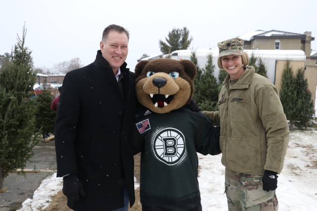 "(from left to right) Bob Sweeney, executive director, Boston Bruins Foundation, Bruins mascot ""Blades,"" and Lt. Col. Lindsey Halter, garrison commander, Devens Reserve Forces Training Area (Devens RFTA) pose for a photo during Trees for Soldiers at Devens RFTA Dec. 6. Trees for Soldiers is an annual event whereby local Massachusetts area non-profit organizations donate free trees to Servicemembers and their families during the holiday season."