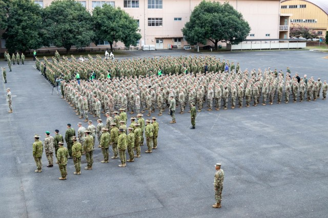 """Japan Ground Self-Defense Force Eastern Army, U.S. Army, Canadian Army, British Army and Australian Army service members stand at attention during the opening ceremony of exercise Yama Sakura 77 at Camp Asaka, Japan, Dec. 9, 2019. """"We lead all of you in bringing the full weight of our forces until we are victorious,"""" said Lt. Gen. Takayuki Onozuka, commanding general of the JGSDF Eastern Army. """"Our shared motto, 'Together to the future!'"""""""