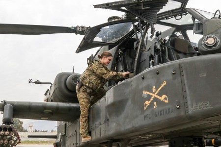 Capt. Carolyn B. Fiore, an AH-64 pilot, conducts preflight external checks to ensure an Apache is fit for flight, March 10, 2019. (U.S. Army photo by Capt. Roxana Thompson)