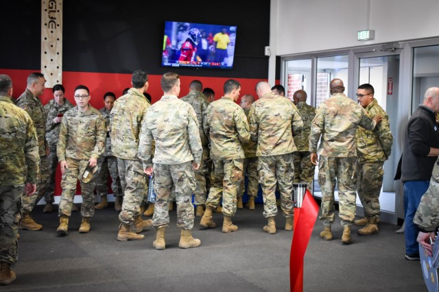 """U.S. Army Garrison Ansbach leadership and 5th Battalion, 4th Air Defense Artillery Regiment leadership and Soldiers gathered in the new Shipton """"We Attack"""" Fitness Center for a ribbon cutting ceremony on Shipton Kaserne, Dec. 9."""