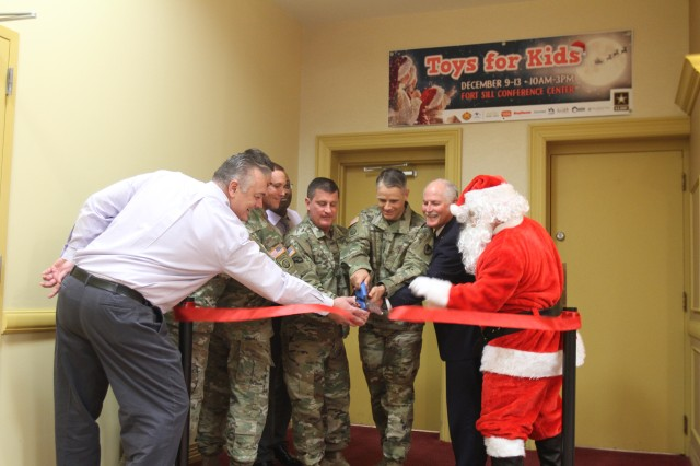 Fort Sill leaders along with Lawton Mayor Stan Booker and Santa Claus cut the ribbon Dec. 9, 2019, opening Toys for Kids at the Fort Sill Conference Center. The resource for eligible service members is open today through Dec. 13, from 10 a.m. to 3 p.m.