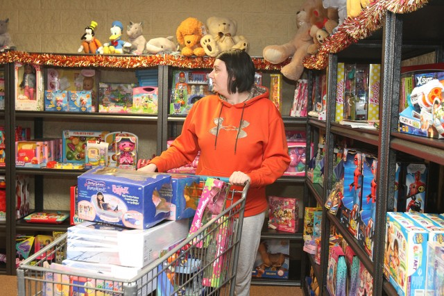 Jennifer Williams, wife of Spc. Tommy Williams, 1st Battalion, 14th Field Artillery, shops for the couple's five children at Toys for Kids at Fort Sill, Okla. Donations of new, unwrapped toys may be dropped off at the Fort Sill Conference Center, Bldg. 6045 Sheridan Road on the basic training side of post.