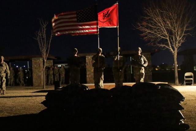Soldiers with the 2nd Engineer Battalion, 3rd Brigade Combat Team, 1st Armored Division, render honors to the colors during the 69th annual Burning of the Colors ceremony, Dec. 5th, on Bulldog field, Fort Bliss, TX. The ceremony is in memorial of those lost during the Korean War Battle of Kunu-Ri in which the battalion commander, Lt. Col. Alarich Zacherle, instructed his Soldiers the burn the battalion colors to prevent them to become a Chinese war trophy. This patriotic act serves as a reminder of selfless service and sacrifice. (U.S. Army photo by: Pfc. Autumn Rogers)