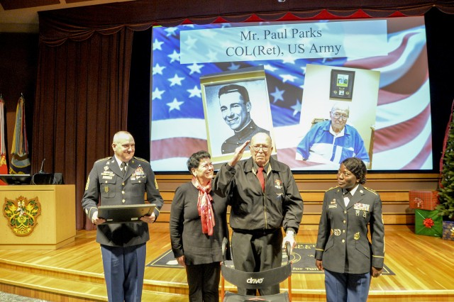 Retired Army Colonel, Col. Paul Parks (center) received a certificate of appreciation for his valuable meritorious service to the Armed Forces, Dec. 6.