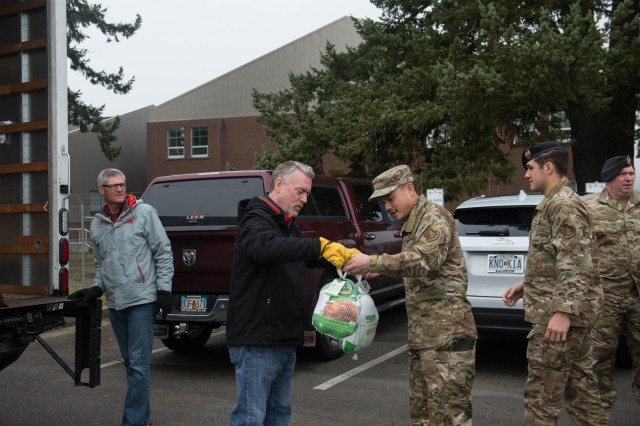 62nd Airlift Wing Airmen unload turkeys during Operation Turkey Drop, Nov. 21 at Joint Base Lewis-McChord. Local businesses donated over 250 turkeys to Team McChord Airmen this year.