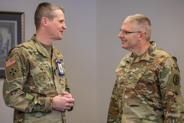 Brig. Gen. Jeffrey J. Johnson (right), the deputy chief of staff for support (G-1/4/6), Office of The Surgeon General and U.S. Army Medical Command, speaking with Madigan Army Medical Center's chief medical noncommissioned officer-in-charge, Sgt. Maj. Justin D. Brog during a facility tour on Dec. 4.