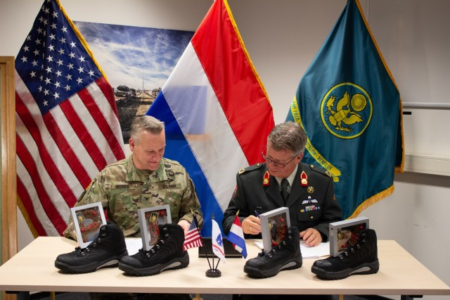 Col. Grand L. Morris, commander, 405th Army Field Support Brigade, and Brig. Gen. Kees de Ritjke, Director Directorate, Personnel and Organization, Royal Netherlands Army, meet to co-sign an updated agreement addressing the way ahead for the Army Prepositioned Stocks Eygelshoven site.