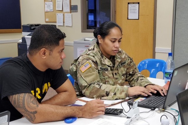 Pago Pago, American Samoa - A U.S. Army Reserve Soldier conducts the administrative portion of the Soldier Readiness Processing event at Pele U.S. Army Reserve Center Dec. 7 to ensure administrative items such as ensuring family data and financial benefits are up to date.