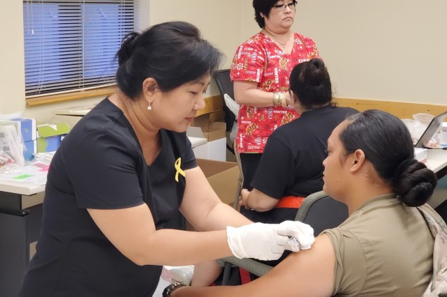 Pago Pago, American Samoa - A U.S. Army Reserve Soldier receives a vaccination during the Soldier Readiness Processing event at Pele U.S. Army Reserve Center Dec. 7.