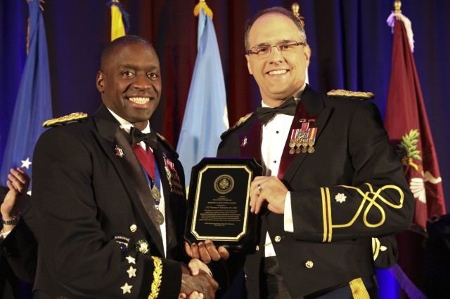 Lt. Col. Thomas H. Edwards was awarded the Association of Military Surgeons of the United States (AMSUS) Research & Development Award on December 5, 2019, at the 2019 AMSUS Annual Meeting in National Harbor, Maryland. The AMSUS Annual Meeting is for military healthcare professionals and leaders to improve the effectiveness, cohesiveness, and esprit de corps of the federal healthcare services. (U.S. Army Image by Jenie Fisher, MEDCOM/OTSG)