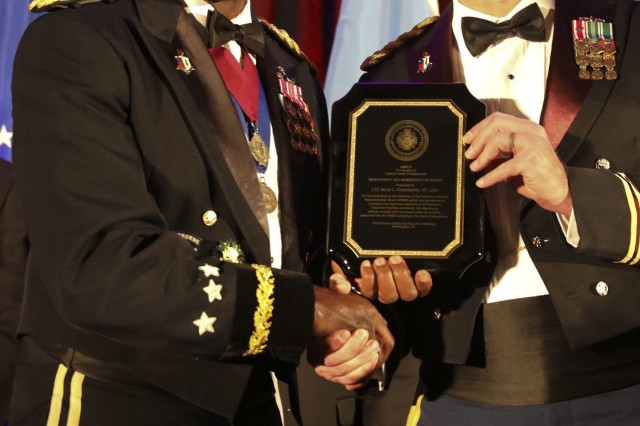 Lt. Col. Scott Chamberlin was awarded the Association of Military Surgeons of the United States (AMSUS) Management and Administration Award on December 5, 2019, at the 2019 AMSUS Annual Meeting in National Harbor, Maryland. The AMSUS Annual Meeting is for military healthcare professionals and leaders to improve the effectiveness, cohesiveness, and esprit de corps of the federal healthcare services. (U.S. Army Image by Jenie Fisher, MEDCOM/OTSG)