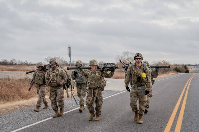 The last three teams of the Cerberus Competition ruck march toward their first station during the competition at Fort Sill, Oklahoma, Nov. 20, 2019.  Twelve Stinger Missile teams and three Sentinel Crew teams participated in the competition.