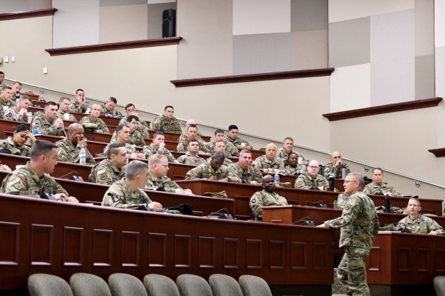 "Combined Arms Center and Fort Leavenworth Commanding General Lt. Gen. Michael Lundy addresses the School for Command Preparation's Pre-Command Course students Dec. 11, 2019 in the Lewis and Clark Center's Marshall Lecture Hall, Fort Leavenworth Kan. The address served as Lundy's last PCC engagement ahead of his change of command ceremony Dec. 16. Lundy spoke to the students about the mission of CAC, capability gaps the Army is working on filling and the modernization of the Army. Lundy said the Army is going to be going through a lot of changes as it works on the Army Modernization Strategy that aims to prepare the Army to be capable of conducting Multi-Domain Operations as part of an integrated joint force in a single theater by 2028 and able to conduct MDO in multiple theaters by 2035. ""If you're not comfortable with change - you'll be less comfortable with being irrelevant,"" Lundy said. PCC is a two-week course conducted 10 times a year for brigade and battalion command selectees and command sergeant major selectees. Photo by Tisha Swart-Entwistle, Combined Arms Center Public Affairs."