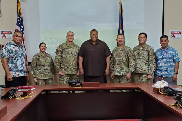 Pago Pago, American Samoa - The command team from the 9th Mission Support Command and Theater Support Group take a photo with American Samoa Lt. Gov. Lemanu Mauga and his staff Dec. 9 at the Emergency Operations Center in Pago Pago.