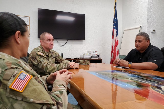 Pago Pago, American Samoa - Brig. Gen. Timothy Connelly, commanding general of the 9th Mission Support Command and Command Sgt. Maj. Jessie Baird meet with Federal Aviation Administration representative, Timothy Faumuina, to discuss Army Reserve access to the flight line to be optimally postured to support the island in the event of an emergency.