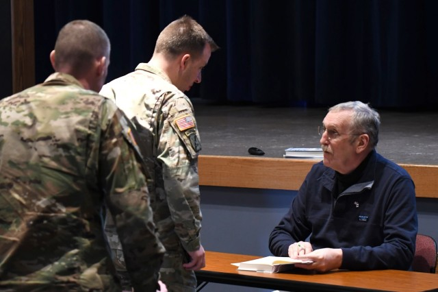 """Maurice Isserman, author and history professor at Hamilton College, visited Fort Drum on Dec. 13 to discuss 10th Mountain Division (LI) history and share excerpts from his latest book """"The Winter Army."""" (Photo by Mike Strasser, Fort Drum Garrison Public Affairs)"""