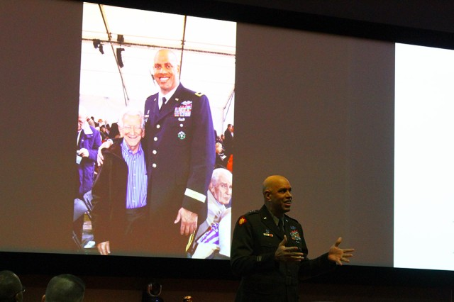 Maj. Gen. Michael Thompson, Adjutant General for the State of Oklahoma, shows a photo of himself with a Dachau concentration camp survivor from 2015. The general spoke about how Oklahoma National Guard Soldiers from the 45th Infantry Division helped liberate the camp in April 1945.