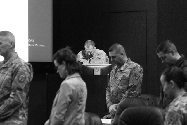 """Chaplain (Col.) Jimmy Nichols (at lectern), Fort Sill installation chaplain, performs the invocation for the National Guard birthday Dec. 13, 2019, in the Reimer Conference Center. He said, """"Oh God … on those warriors and family members assembled here who serve God and country with integrity befitting honor, I ask your blessing."""""""