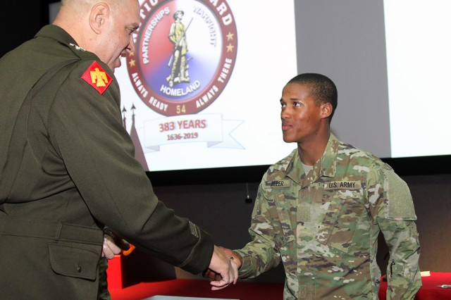Maj. Gen. Michael Thompson, Adjutant General for the State of Oklahoma, presents his coin of excellence to Pvt. Elias Zeller, age 17, the youngest National Guard Soldier at Fort Sill, Dec. 13, 2019, at Snow Hall. Zeller is in week 5 of Basic Combat Training with C Battery, 1st Battalion, 40th Field Artillery.