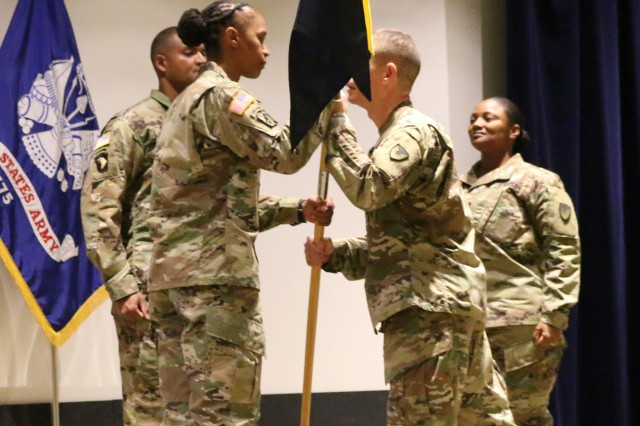 Capt. Melanie Appleton accepted the Headquarters and Headquarters Company, U.S. Army Aviation and Missile Command, unit colors from Col. Rick Zampelli, AMCOM chief of staff during the HHC change of command ceremony.