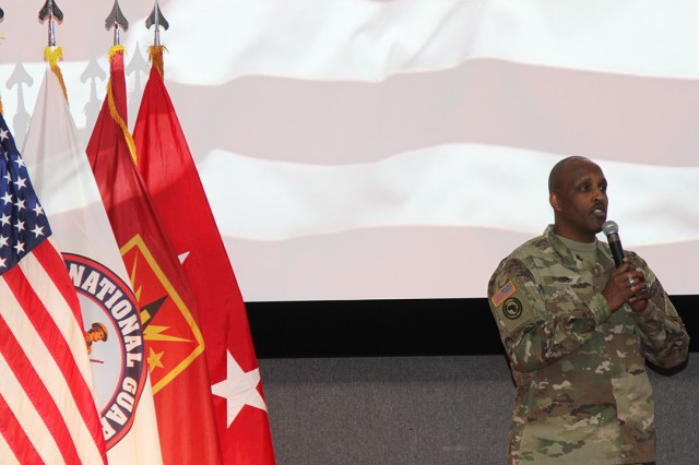 """Master Sgt. Robert Burns, 434th Field Artillery Brigade Reserve Components liaison, sings """"The Star-Spangled Banner"""" a cappella Dec. 13, 2019, during the National Guard birthday at Snow Hall."""