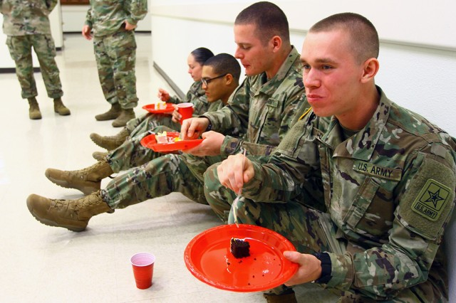 Afterward, guests, including Advanced Individual Trainee air defenders, were treated to cake and soft drinks. Pvt. Dakota Dowd (left), B Battery, 3rd Battalion, 6th ADA, enjoyed a piece of cake.