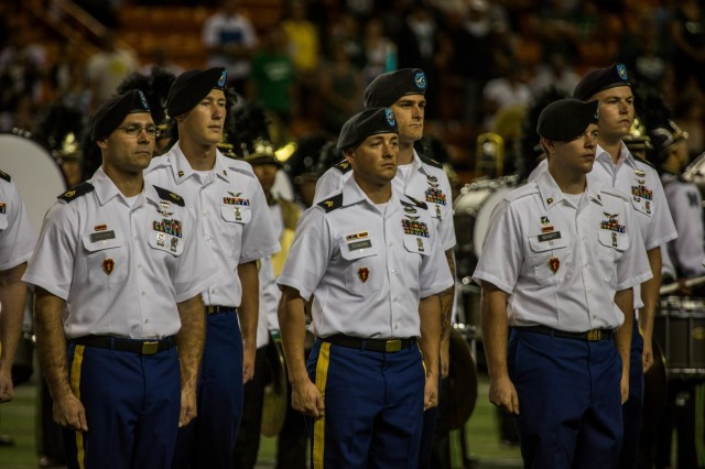 """Service members from all branches were recognized for their service during the half-time show of the University of Hawaii Rainbow Warriors Football versus San Jose State Spartans Veterans Military Appreciation Game at the Aloha Stadium in Honolulu, Nov. 9.  Army Soldiers assigned to """"Hillclimbers"""" B Co., 3-25 Aviation Regiment, 25th Combat Aviation Brigade, 25th Infantry Division, were recognized after returning home from a 9 month deployment to Afghanistan.(U.S. Army photos by Sgt. Sarah D. Sangster)"""
