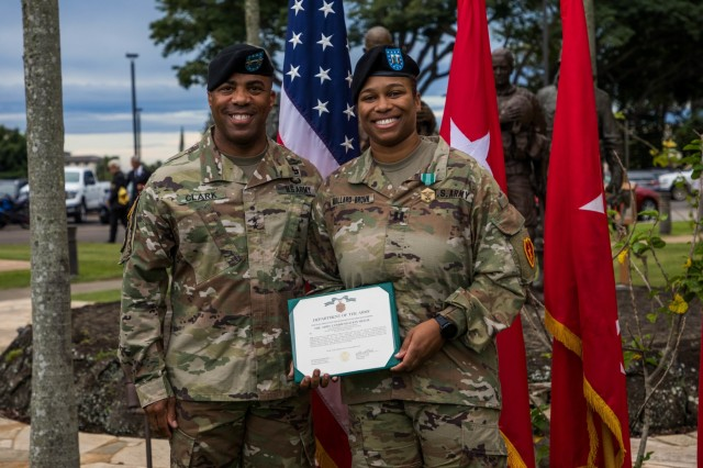 Maj. Gen. Ronald P. Clark awards Capt. Kimberly Mallard-Brown the Army Commendation Medal in an award ceremony before the 25th Infantry Division Change of Command Ceremony on Nov. 5, 2019 at Schofield Barracks, Hawaii. (U.S. Army photo by Sgt. Sarah D. Sangster)