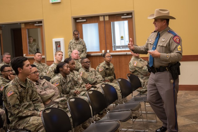 Army veteran and Texas Department of Public Safety Trooper Ruben San Miguel speaks to Soldiers and leaders about the importance of highway safety. Soldiers and leaders from 49th Transportation Battalion and Headquarters and Headquarters Company, 13th Expeditionary Sustainment Command, participated in a Safety Stand Down event at the Spirit of Fort Hood Chapel Dec. 13.