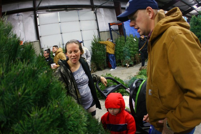 The Hawes family peruses the large selection of trees during Trees for Troops Dec. 14, 2019, at Bldg. 3321, Naylor Road. The giveaway continued Dec. 15, from noon to 5 p.m. for veterans and DA civilians.