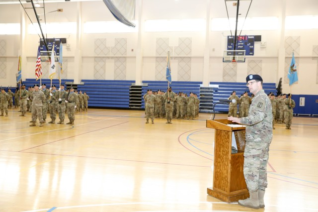 Col. Jamie Walsh, commander, 501st Military Intelligence Brigade, bade farewell to outgoing Command Sgt. Maj. Kristen Grover, and welcomed Command Sgt. Maj. Michael Martino during his speech at the brigade change of responsibility ceremony at Zoeckler Gym on Camp Humphreys, Dec. 9, 2019. (U.S. Army photo by