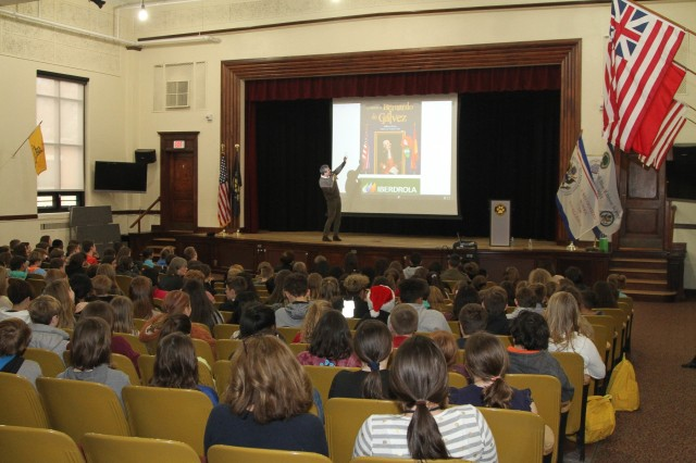 Guillermo Fesser speaks and laughs with students while teaching them about the processes involved with developing a children's book Dec. 5 at the West Point Middle School.
