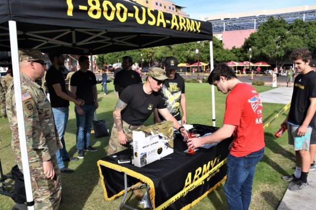 Staff Sgt. Justin Zorn, recruiter, Tempe Recruiting Company, engages a potential lead, prior to Arizona State University's Salute to Service college football game between ASU and the University of Southern California, Nov. 9, Sun Devil Stadium, Tempe, Ariz.
