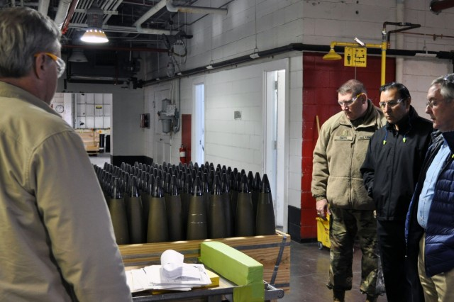 Members of the Organic Industrial Base examine rounds marked for demilitarization at Crane Army Ammunition Activity during a several day collaboration designed to examine demilitarization equipment and processes. CAAA is an important part of the Joint Munition Command's demilitarization operations across the OIB enterprise.