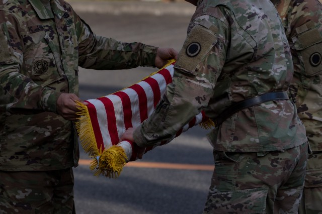 America's First Corps Soldiers case the colors for travel following the Yama Sakura 77 closing ceremony at Camp Asaka, Japan, Dec. 15, 2019. Each year the exercise location rotates between the five regional armies of the JGSDF, with the Eastern Army, based out of Camp Asaka, hosting First Corps this year.
