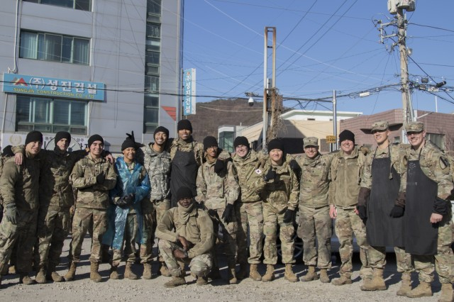 Soldiers assigned to the 210th Field Artillery Brigade and the 6th Squadron, 9th Cavalry Regiment, 3rd Armored Brigade Combat Team, both part of the 2nd Infantry Division/ROK-U.S. Combined Division pose for a group photo during the charcoal briquette distribution, Dec. 5, 2019, Dongducheon, Republic of Korea. About 90 soldiers volunteered to help deliver the charcoal briquettes to neighbors in need. (U.S. Army photo Pfc. Jaeyoung Park)