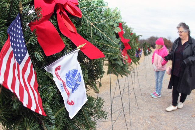 Charlotte Bays and her granddaughter Katonna Marshall, 7, view the armed forces wreaths on display during Wreaths Across America Dec. 14, 2019, at the Fort Sill Post Cemetery. Bays father, Master Sgt. Donald Broughton, is buried there.